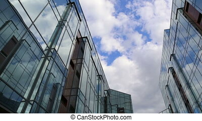 Clouds reflected in mirrored walls.