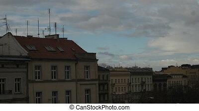 Timelapse of clouds behind buildings