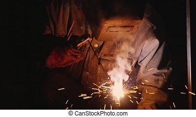 Hard Labour. Electric welder at work. Many sparks