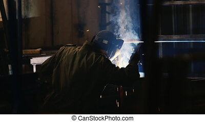 Silhouette of electric welder at work Hi quality ProRes...