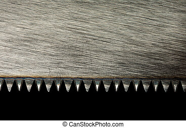 Saw blade - Closeup of saw blade isolated on black