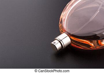 Bottle of perfume on black background