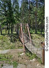 Rope bridge in Prevails Mali town or Tsari Mali grad...