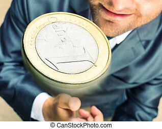 Toss a coin - Smiling businessman tossing a coin