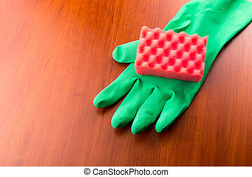 Green cleaning glove with a sponge