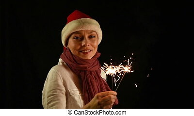 Pretty girl in red Christmas Santa with Sparklers