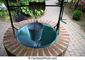 wishing well with a bucket for charity or donation