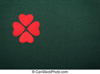 clover red - clover made of red hearts on green background