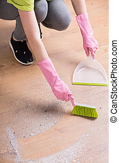 Person cleaning floor with dustpan - Image of person...