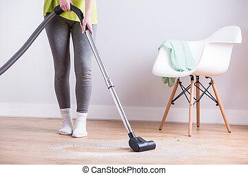 Maid vacuuming floor - Image of maid vacuuming floor in...