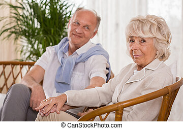 Elderly man looking at his wife with love and tenderness