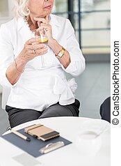 Elderly businesswoman on a meeting - Elderly businesswoman...