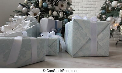 Woman puts a gift under the Christmas tree