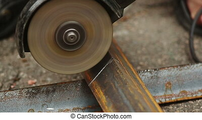 Sawcutting a Metal - Sawcutting a metallic detail of...
