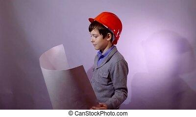 builder boy teen in helmet holding building plan documents
