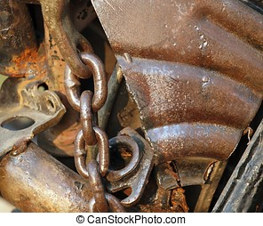 Junk Yard Closeup - Rusted pieces of scrap metal thrown on a...