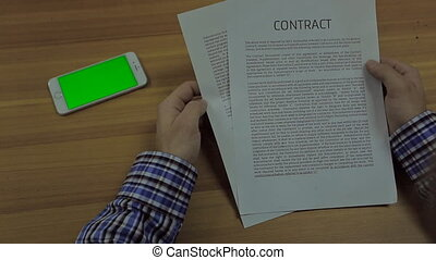 phone devices Screen Mock Up and man hands holding  a standard form of business contract with text