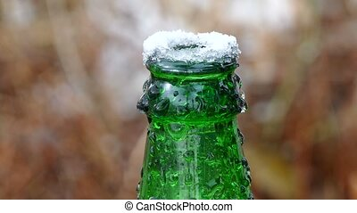 beer bottle neck on top of ice frozen - beer bottle neck on...