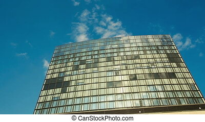Office Building With Timelapse Clouds - Office building with...