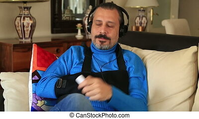 Painful man with a broken arm wearing arm brace sitting on a...