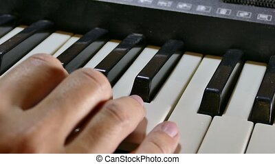 man playing the piano synthesizer hand run over the keys -...