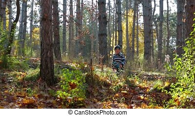 Happy Child Running In Autumnal Forest - In the frame there...