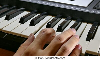 man playing piano synthesizer hand run over the keys - man...