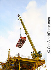 Crane operation transfer cargo on the platform and moving...