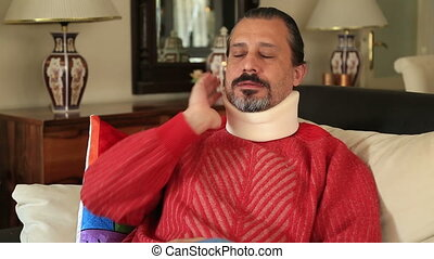 Painful man with neck brace