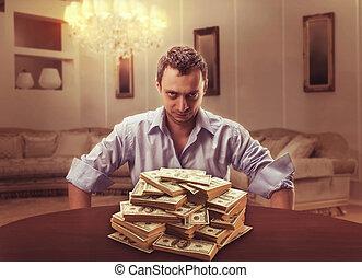 Suspicious lender - Suspicious businessman sits looking at...