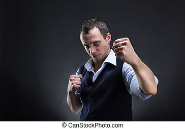 Fighting businessman over grey background