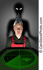 Aliens invasion - Bizarre man wearing a foil hat and...
