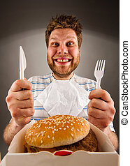 Ready to eat burger - Portrait of happy man with knife and...