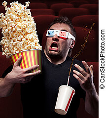Very scared man watching 3D movie - Portrait of very scared...