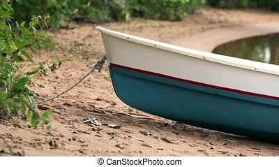 rowing boat on the beach close to - rowing boat on the beach...