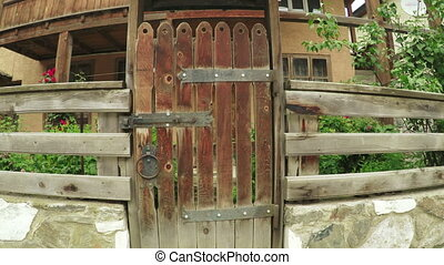 Old wooden house - Behind old wooden gate in countryside in...