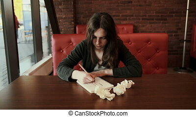 girl in a creative process drawing crumples pape - teenager...