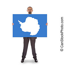 Smiling businessman holding a big card, flag of Antarctica,...