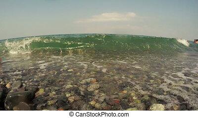 Pebbles and surf - On pebble beach foam sea surf