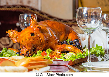 Roast pig - Roasted pig on rich table in eastern restaurant