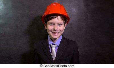 Teen boy builder in helmet smiling portrait - Teen boy...