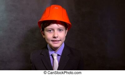 teen portrait boy builder in helmet smiling - teen portrait...