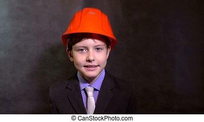 teen portrait boy builder in helmet smiling - teen portrait...
