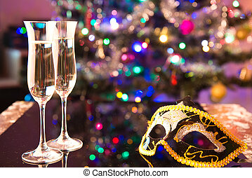 two champagne glasses and a mask - Two glasses of champagne...