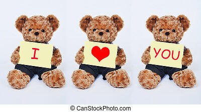 Teddy bear holding a  yellow sign saying I love you isolated on white background