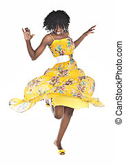 african woman dancing - young african with yellow dress and...