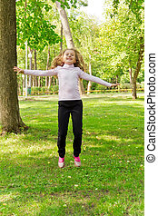 Jumping girl in summer