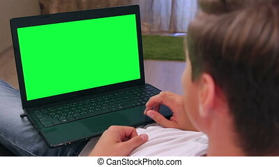 Man with laptop close up - Online communication. The view...
