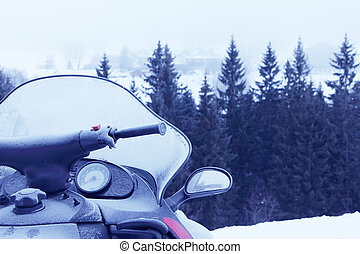 Snowmobile - Side view of Snowmobile in winter mountains...