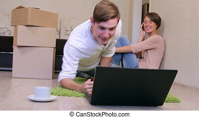 Young couple Online shopping - Newlyweds in a new apartment...